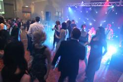 Stage lighting floods the dancefloor