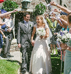 Mr & Mrs Adlem covered in confetti