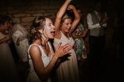 Bride & bridesmaid cheer the band