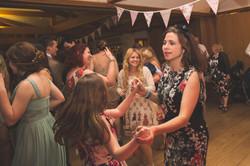Wedding uests smiling & dancing