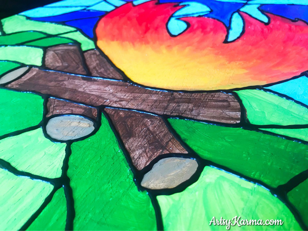 camp fire design outlined in puffy paint