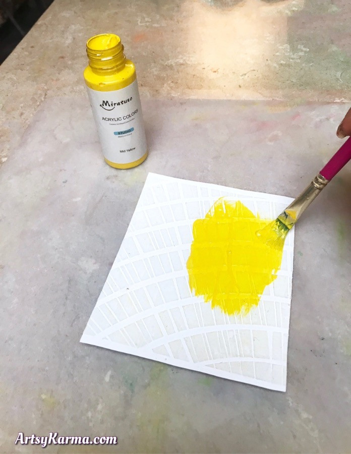 Create a colorful mixed media background with texture paste