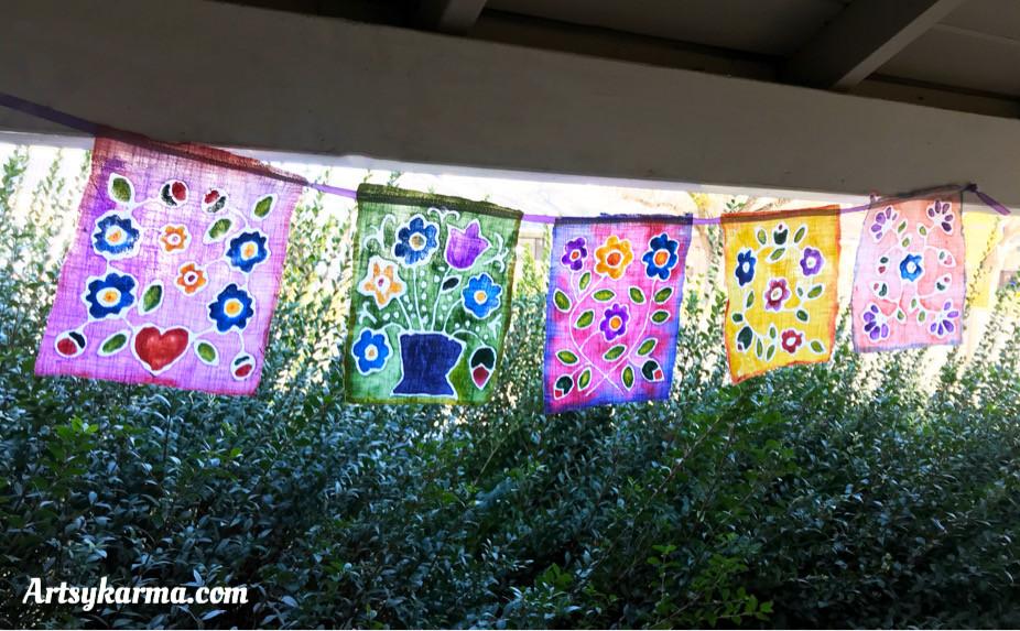 string of folk art flower prayer flags