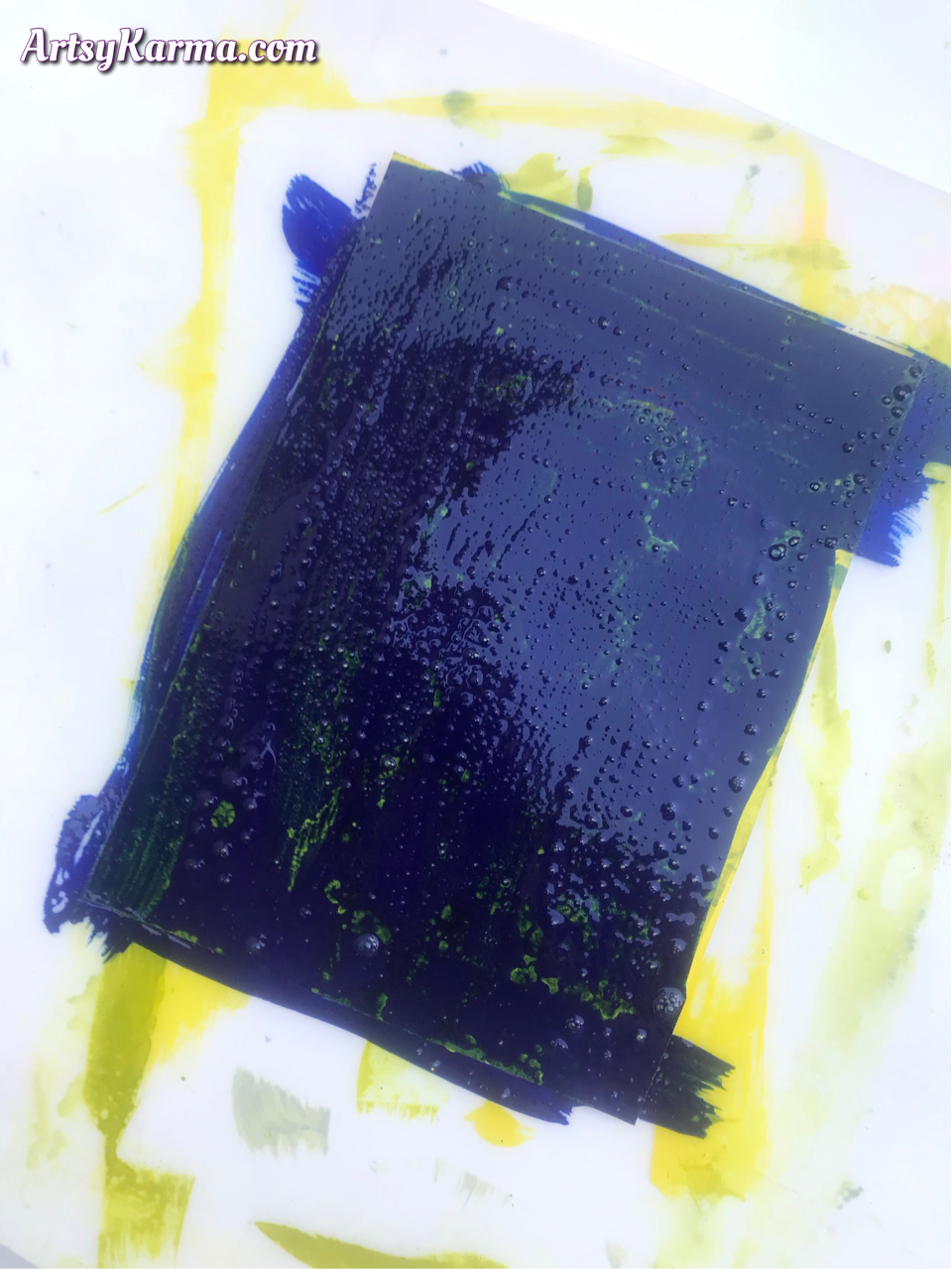 Layering acrylic paints and rubbing alcohol