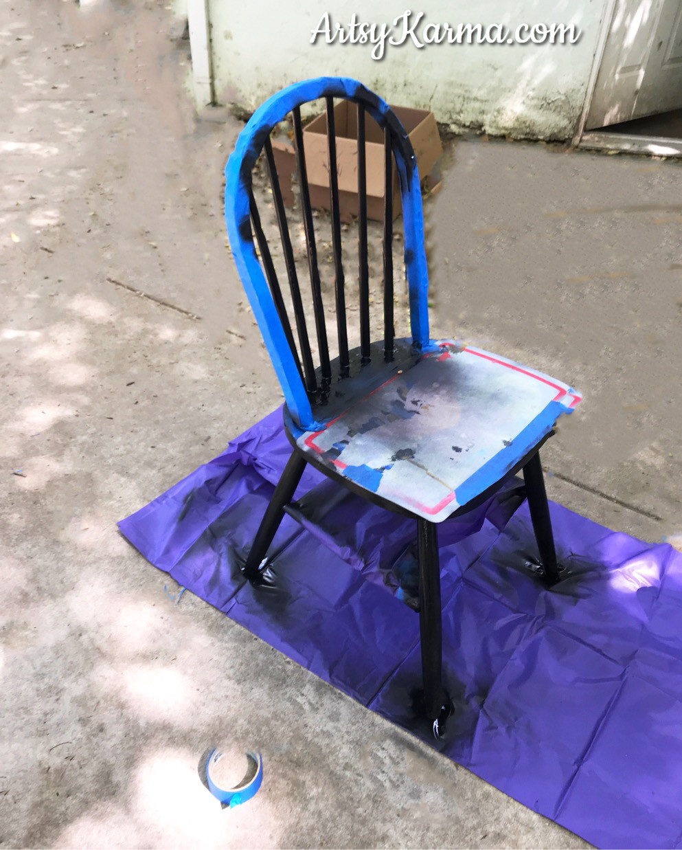 spray paint sections of chair black for makeover