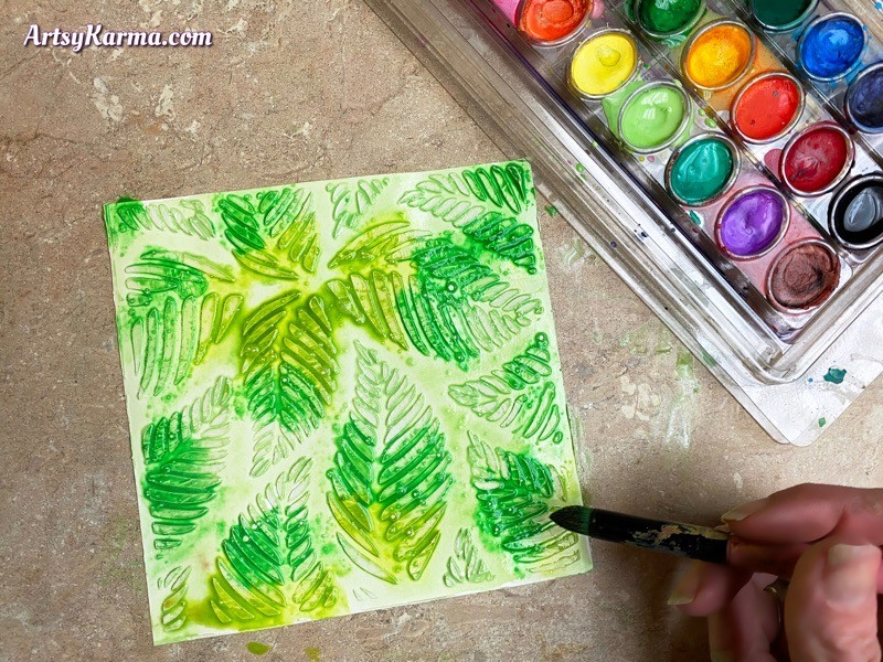 Mixed media background using watercolors and texture paste