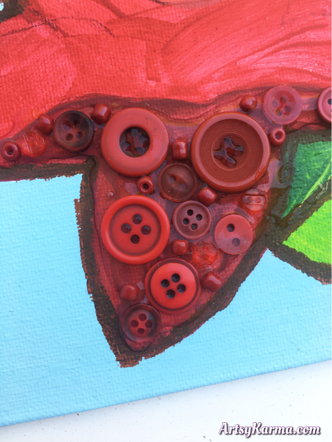 Button art can include beads as like a collage