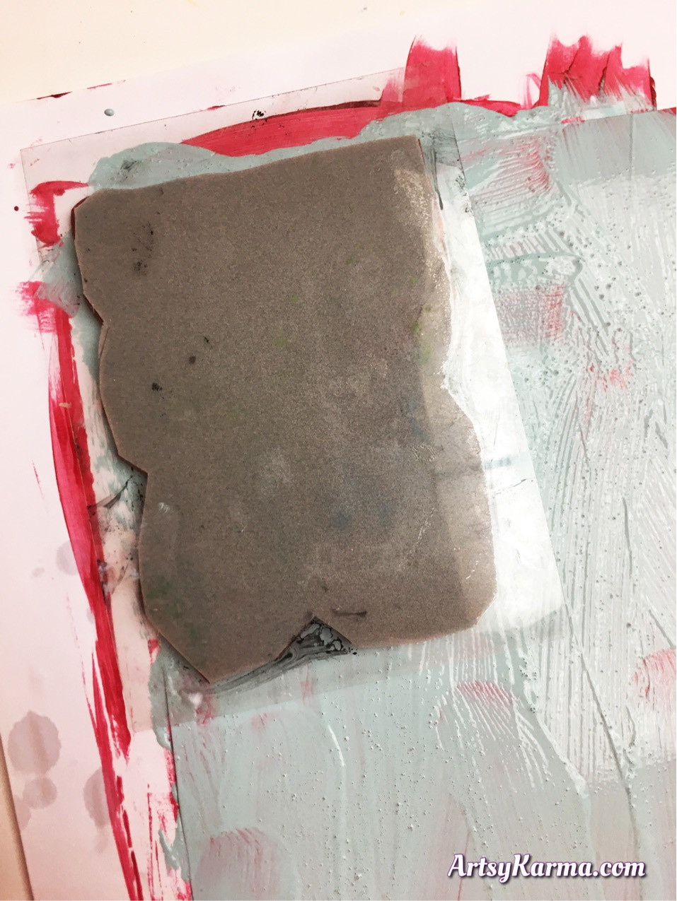 Press your stamp into wet paint do to the subtractive stamping technique