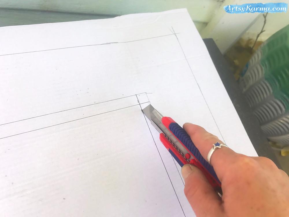 cutting the cardboard  for a diy frame
