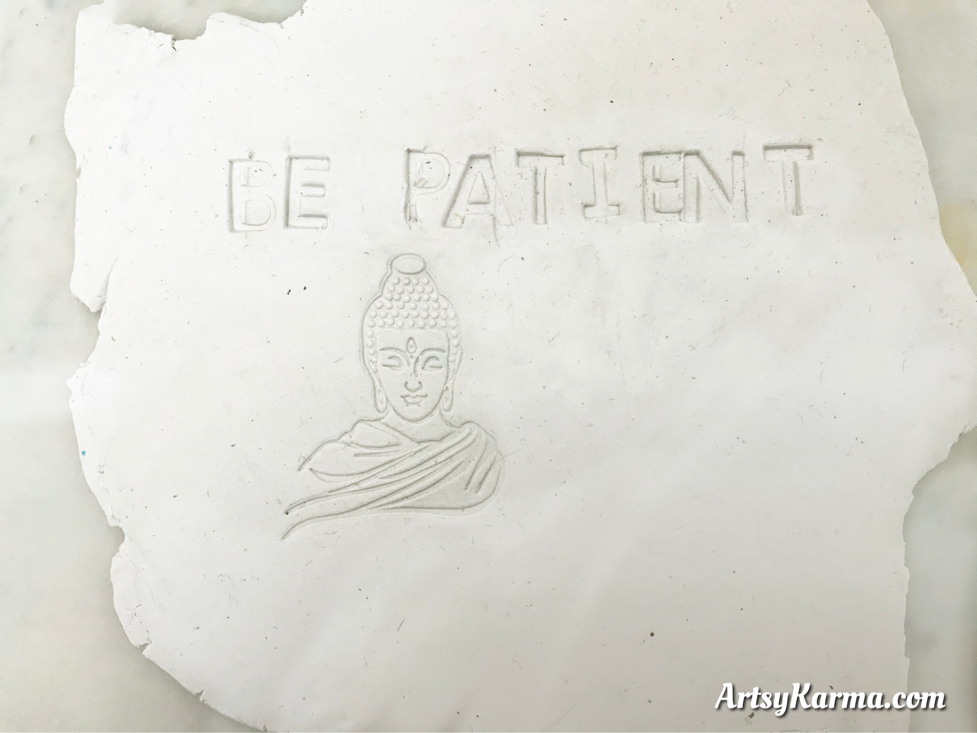 stamp images into clay
