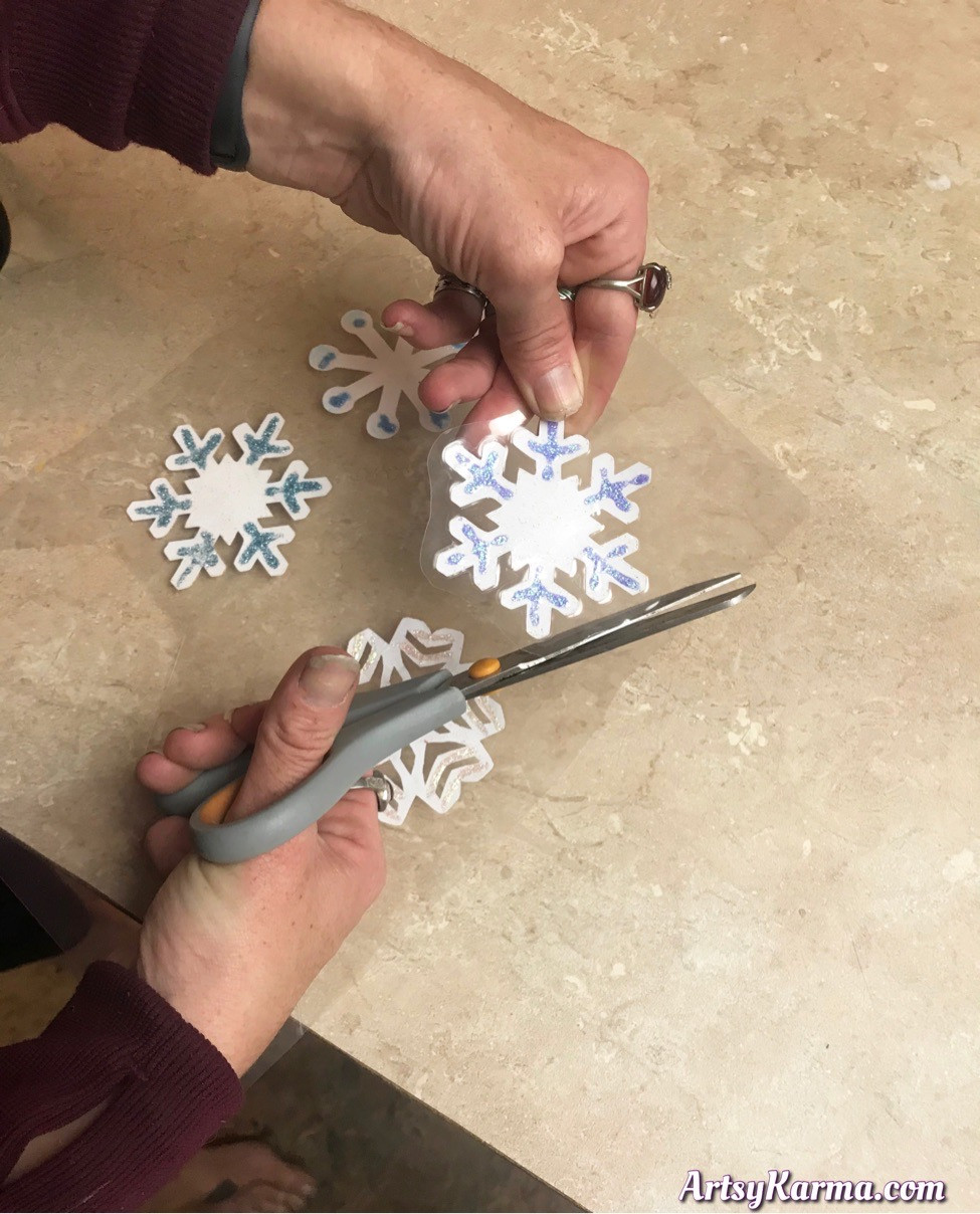 Cut out your laminated diy snowflakes