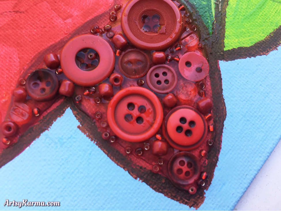 Beads and buttons on canvas make a diy button project