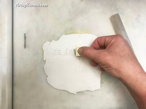 use alphabet stamps for handmade clay plaques