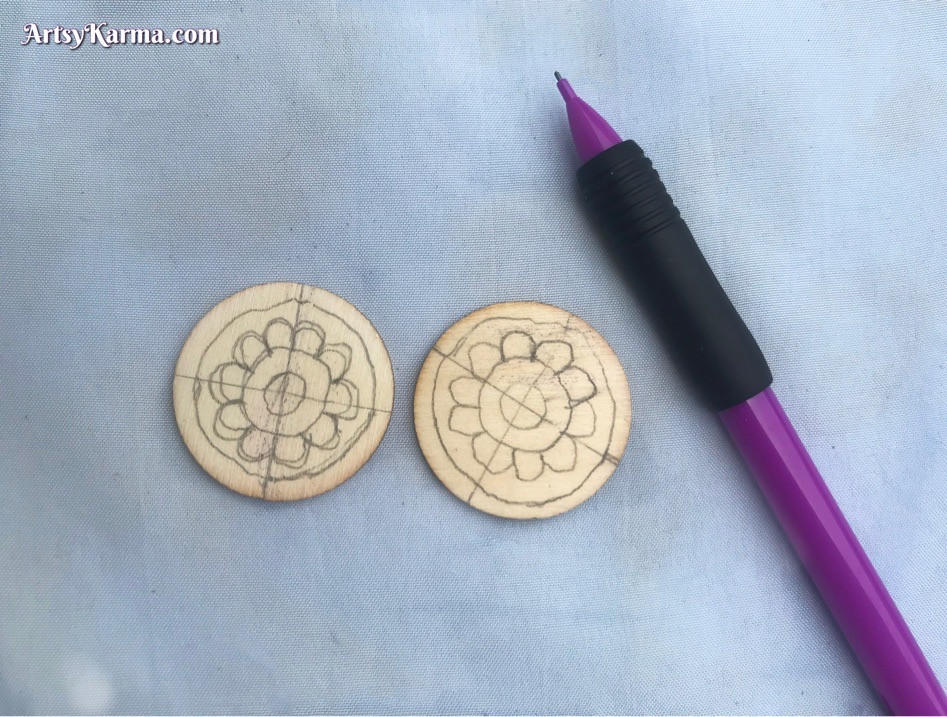 Designing a mandala on wooden slices to decorate with rhinestones
