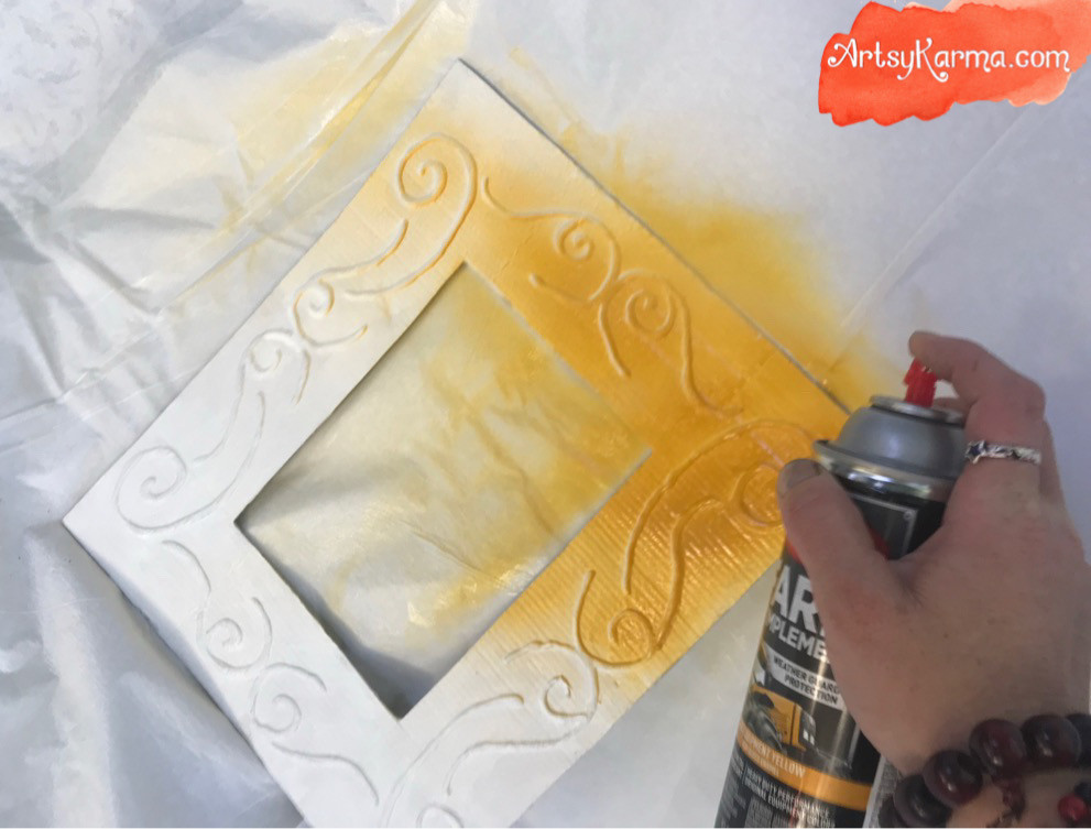 spray paint the embossed frame