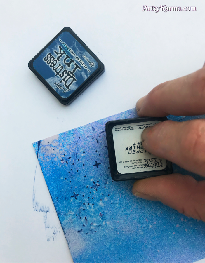Use distress inks to dry embossed areas of card stock