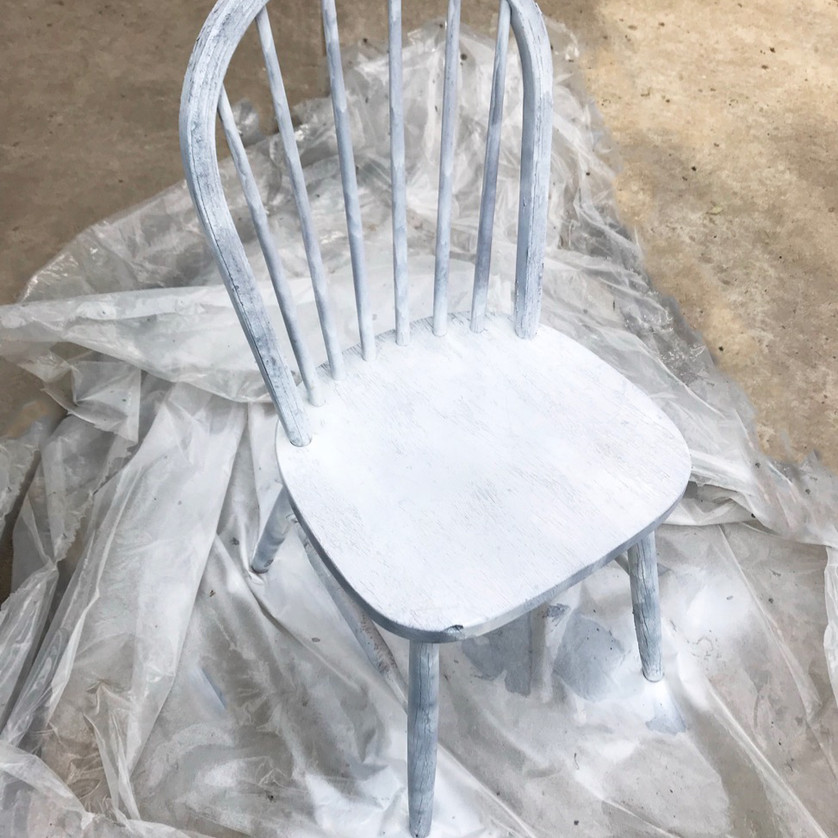 prime the chair before your paint makeover