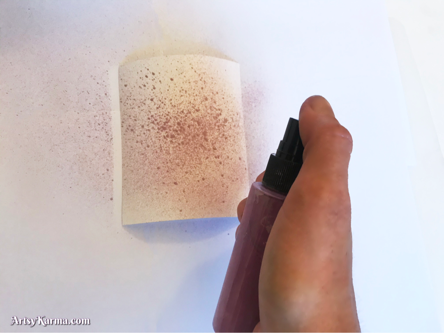 Spray ink on card stock to make cool backgrounds for paper art