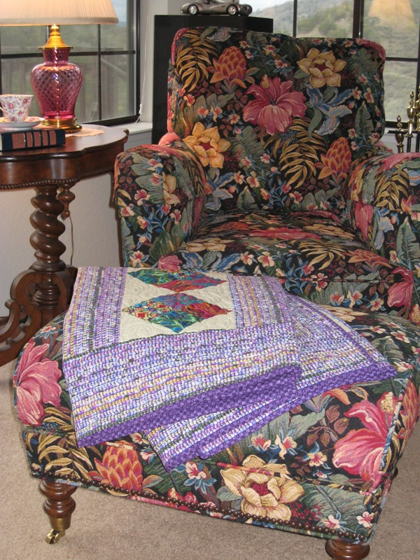 Jewel Tone Quilt on an ottoman