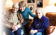 Elderly husband and wife with carer
