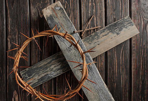 Crown of thorns on wood desk. Christian