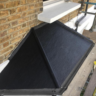 Bay window roof. Applied asphalt paint to a bay window roof - South Woodford