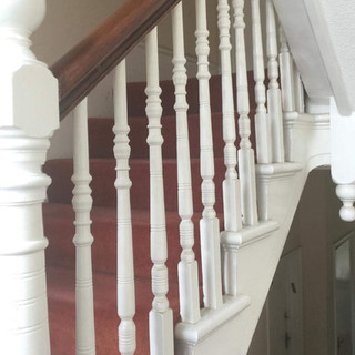Stained banister rail with painted white spindles and stairs