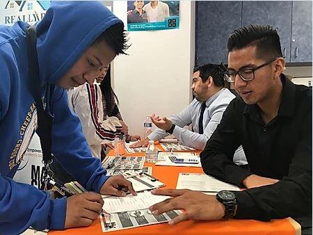 photo of Walter Cruz helping a teen