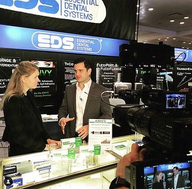 Dr. Chris Salierno shootig video at the Greater NY Dental Meeting