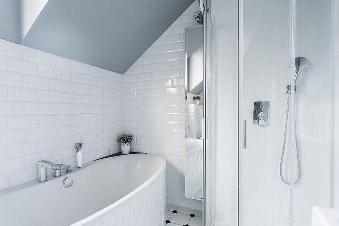 Exclusive white bathroom with bath and s