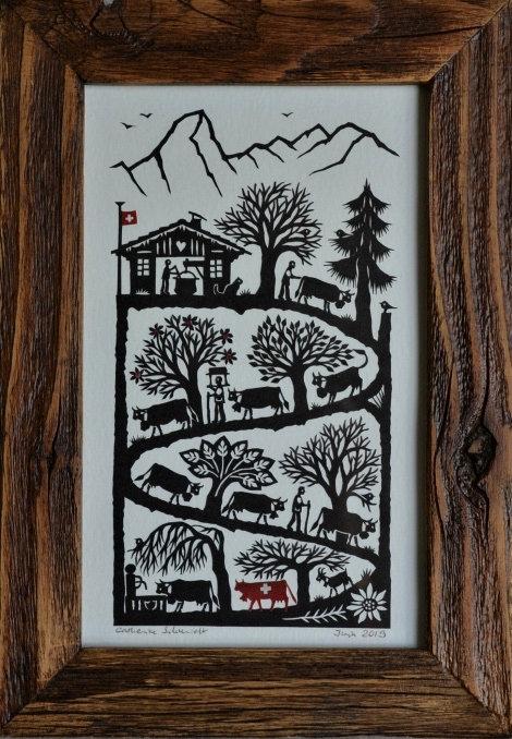 Poya verticale et une vache suisse