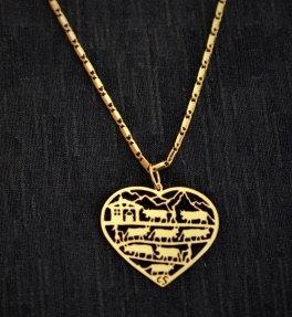 Collier motif poya-coeur, doré