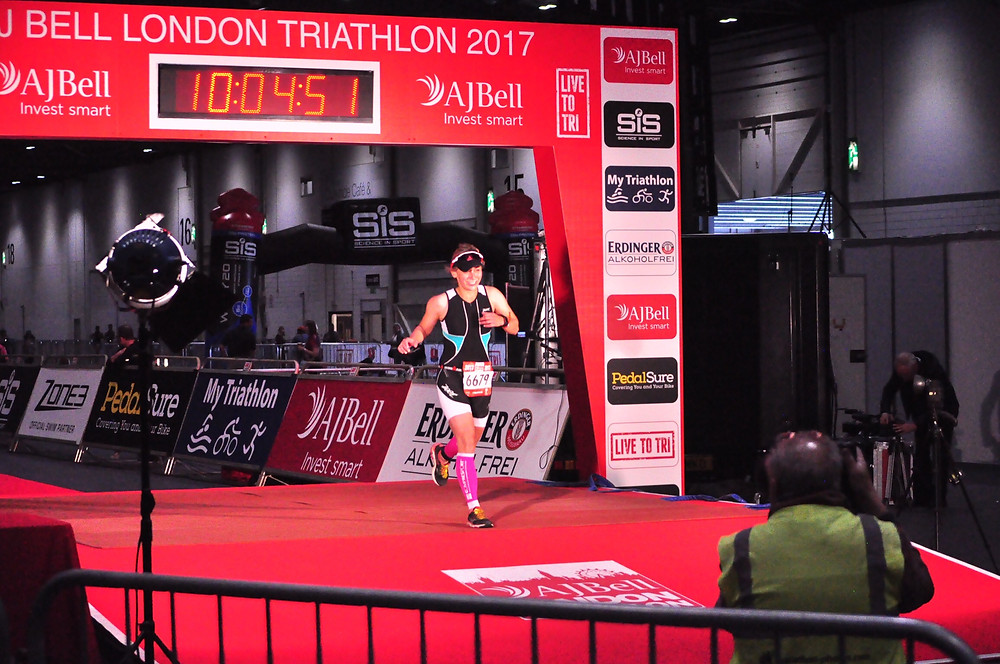Physio crossing triathlon finishing line