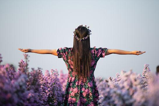 joyfull-woman-purple-dress-among-purple-