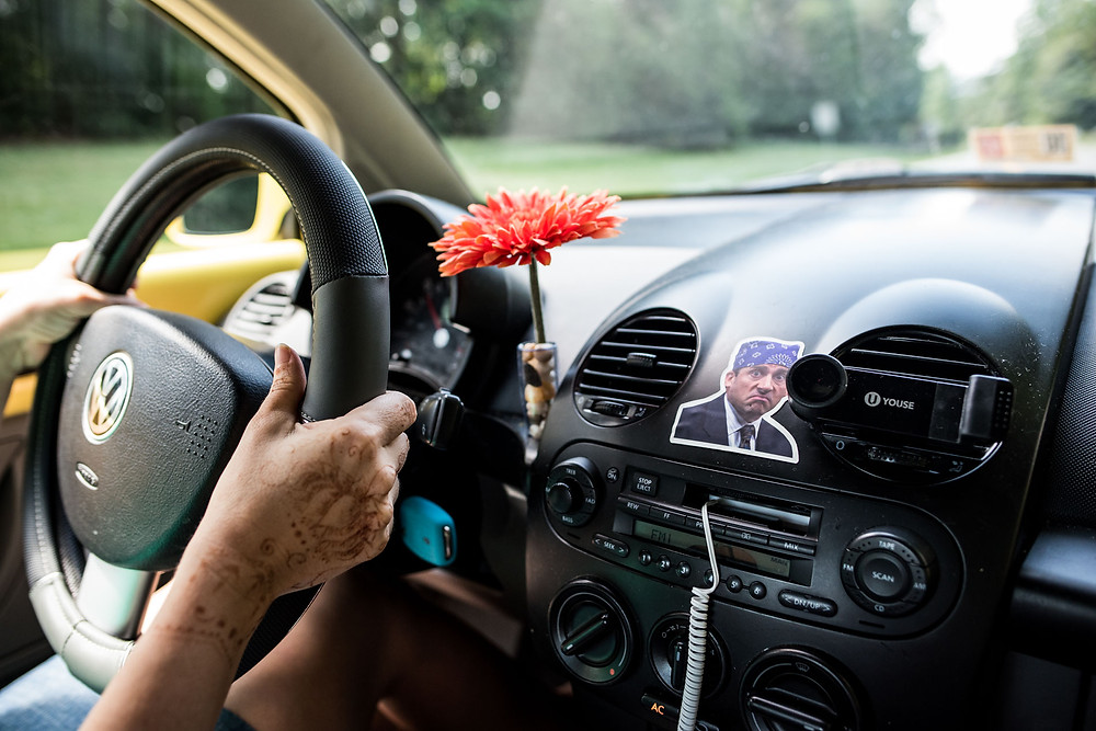 Mom driving Volkswagon Beetle