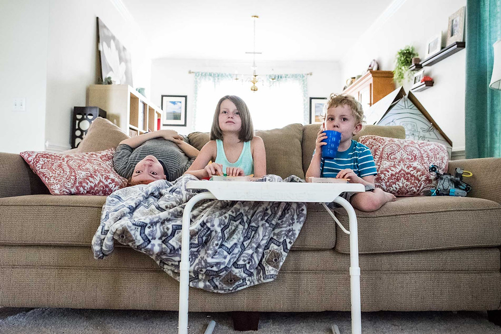 Kids sitting on couch watching TV