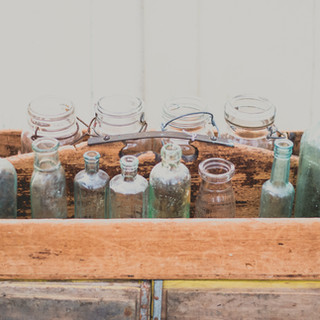 variety clear glass jars wooden carrier.
