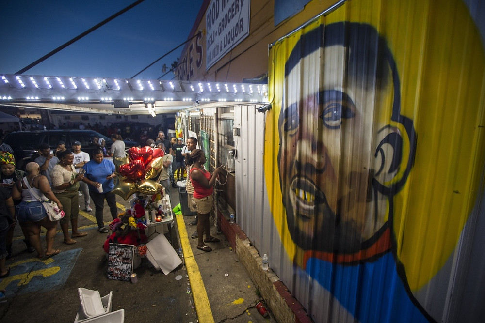mural painted on the wall of the convenience store where Alton Sterling was shot and killed, July 6, 2016 in Baton Rouge, Louisiana. Sterling was shot by a police officer in front of the Triple S Food Mart in Baton Rouge on Tuesday, July 5, leading the Department of Justice to open a civil rights investigation.