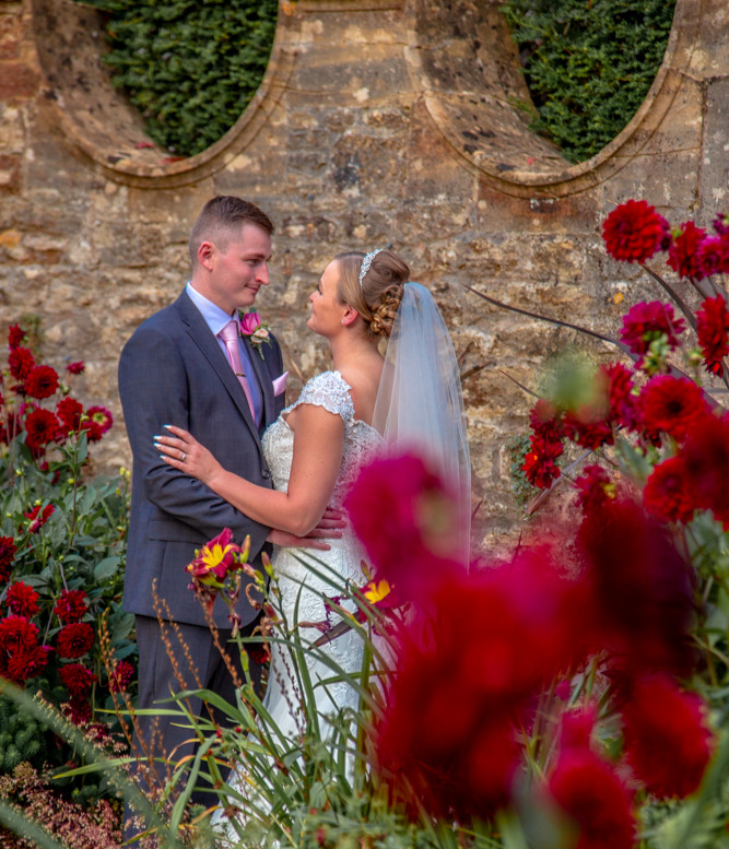 Bride and Groom in a lovely private moment in the Kitchen Gardens