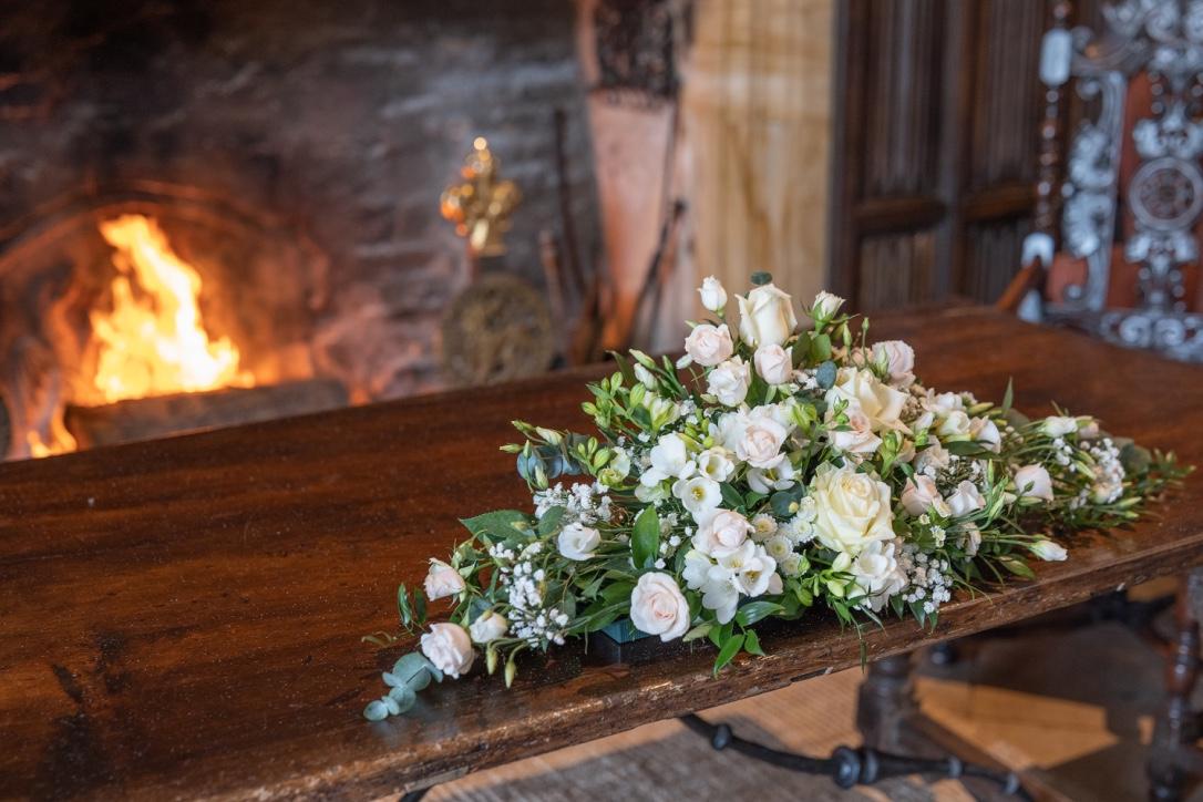 Flowers on the wedding ceremony table at Athelhampton