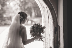 A Bride waits at the from door of Athelhampton