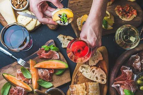 italian-wine-snack-variety-mans-hands-ho