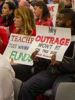 Teachers and advocates show up in large numbers at regional budget hearings.