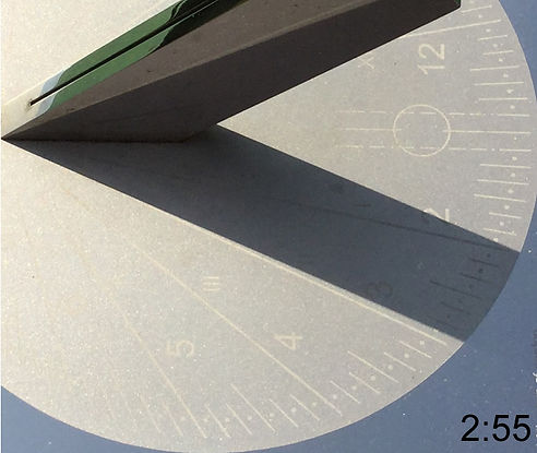 Video of shadow mving across a sundial by Piers Nicholson