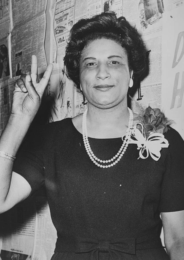 Mrs. Constance B. Motley first woman Senator, 21st Senatorial District, N.Y., raising hand in V sign