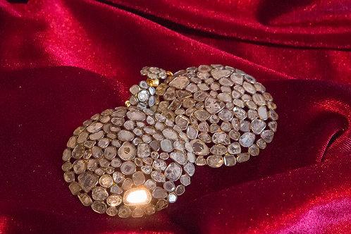 Orecchini in oro e argento a rosette di diamanti