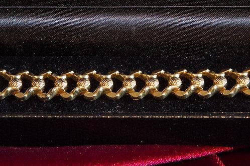 Bracciale in oro a elementi stampati anni '70