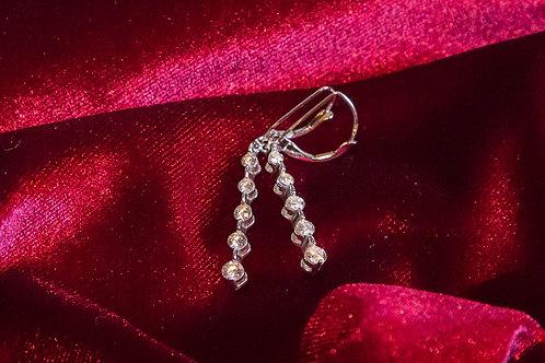 Orecchini pendenti a 5 diamanti in oro bianco