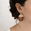 Thumbnail: Temwe oorbellen