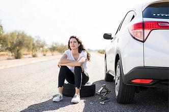 woman flat tyre.jpg